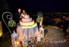 Taglio della torta nuziale al termine del ricevimento di matrimonio a Villa Pocci / 1