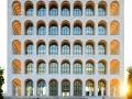 Gli sposi ritratti davanti al Palazzo della Civiltà del Lavoro (noto a Roma come il Colosseo quadrato)